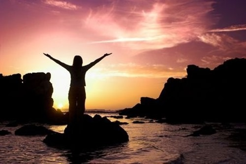 Woman-sunset-arms-outstretched
